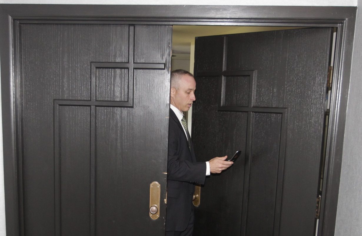 New York State Police Senior Investigator Josh Keats at the door of Steve Pigeon's condo at Admirals Walk after raid on May 28, 2015. May 28, 2015. (John Hickey/Buffalo News)