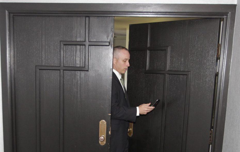 New York State Police Senior Investigator Josh Keats at the door of Steve Pigeon's condo at Admirals Walk after raid on May 28, 2015. May 28, 2015. (John Hickey/Buffalo News)