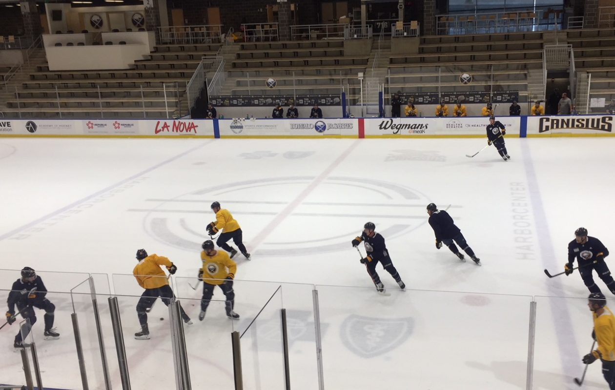 Sabres players hold an informal scrimmage Wednesday in HarborCenter (Mike Harrington/Buffalo News)