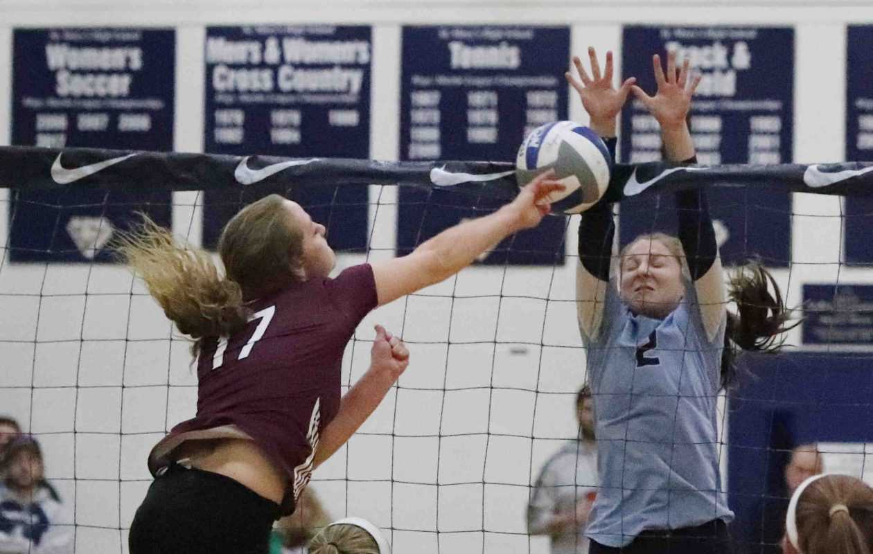 Portville's Sierra Keim spikes the ball past St. Mary's Courtney Kurkowiak in the first game of their volleyball match won by the Panthers in five sets. (James P. McCoy/Buffalo News)