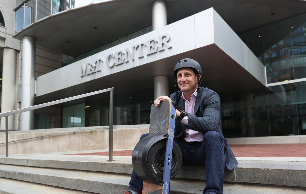 'Everybody's got a real challenge when it comes to just the blistering pace of change,' says Michael Wisler, 43, chief information officer of M&T bank, shown with the Onewheel he says 'I ride pretty much anywhere.' (Sharon Cantillon/Buffalo News)