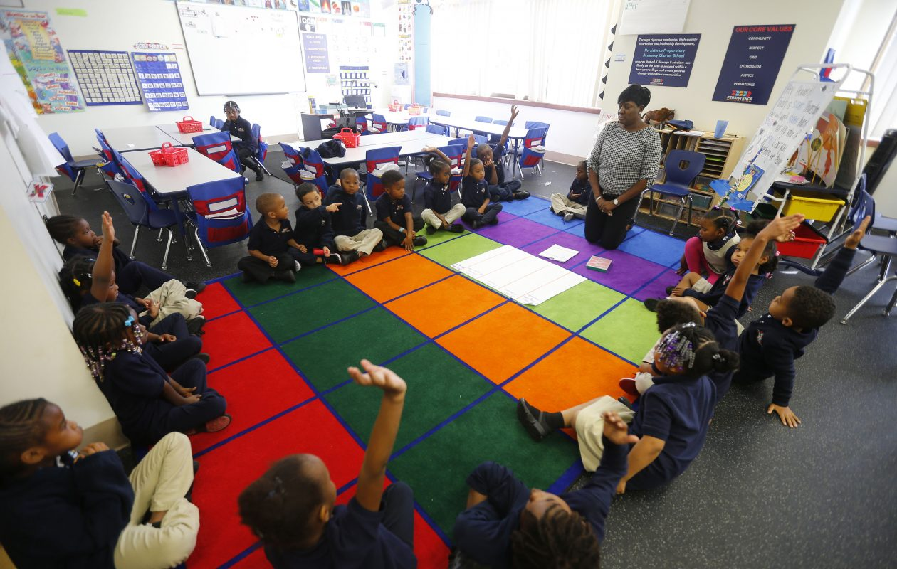 Kindergarteners run through a lesson with teacher Tracey Thomas at Persistence Preparatory Academy in Buffalo. (Mark Mulville/Buffalo News)