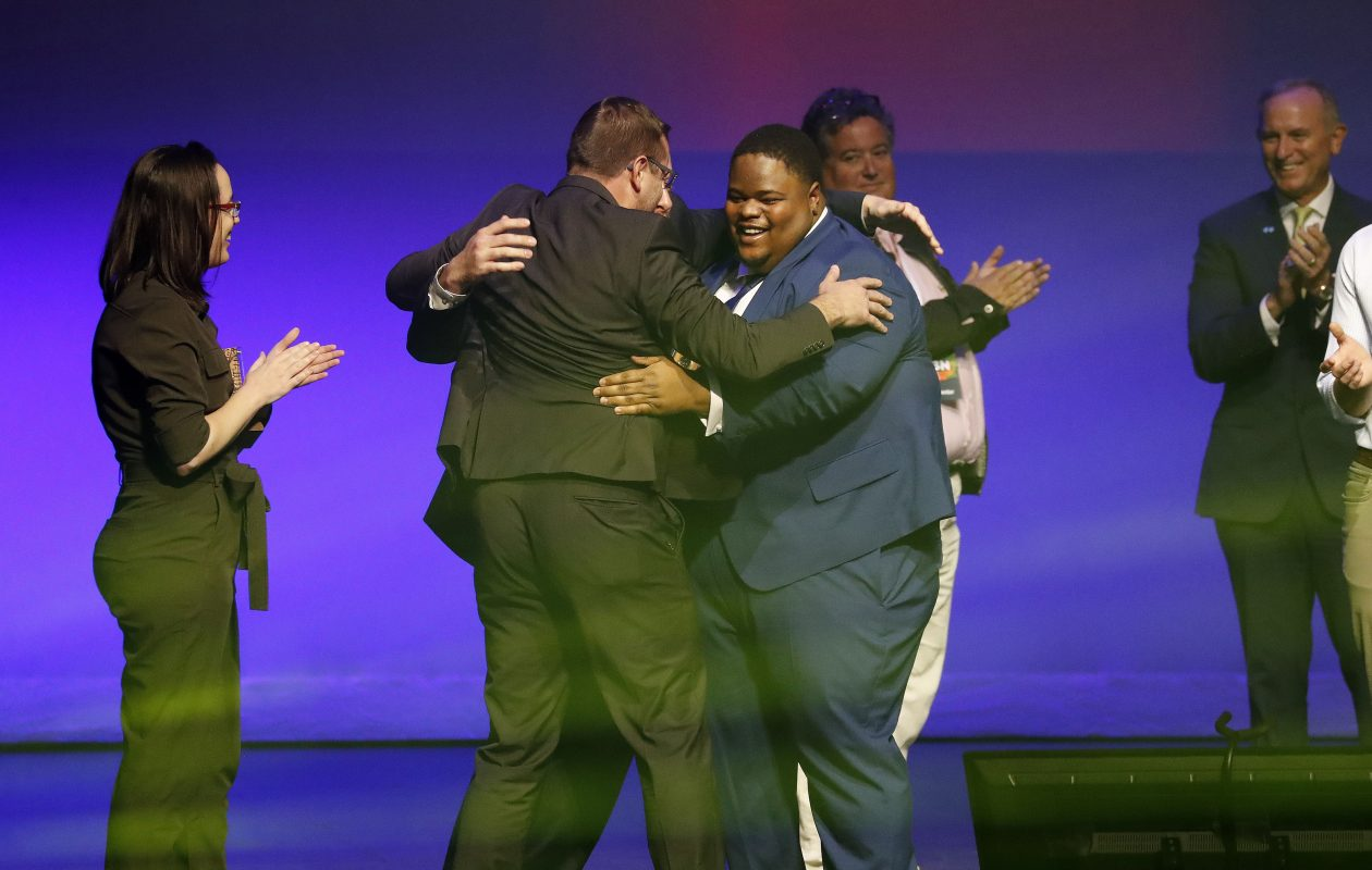 Joshua Aviv, Founder and CEO of Sparkcharge, celebrates with his colleagues Richard Whitney and Christopher Ellis after winning the $1 million dollar prize in the finals of the 43 North competition at Shea's Performing Arts Center on Wednesday. (Mark Mulville/Buffalo News)