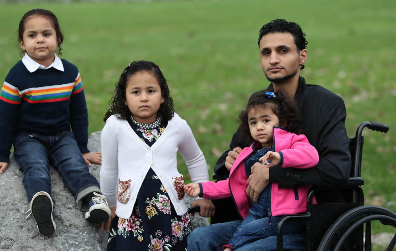 Khaled Soliman with his three children, from left: Zaid, 4, who suffered third-degree burns; Zainab, 6, who her father held as he jumped from the second floor; and Tasneem, who was 6 months old at the time of the fire. (Sharon Cantillon/Buffalo News)