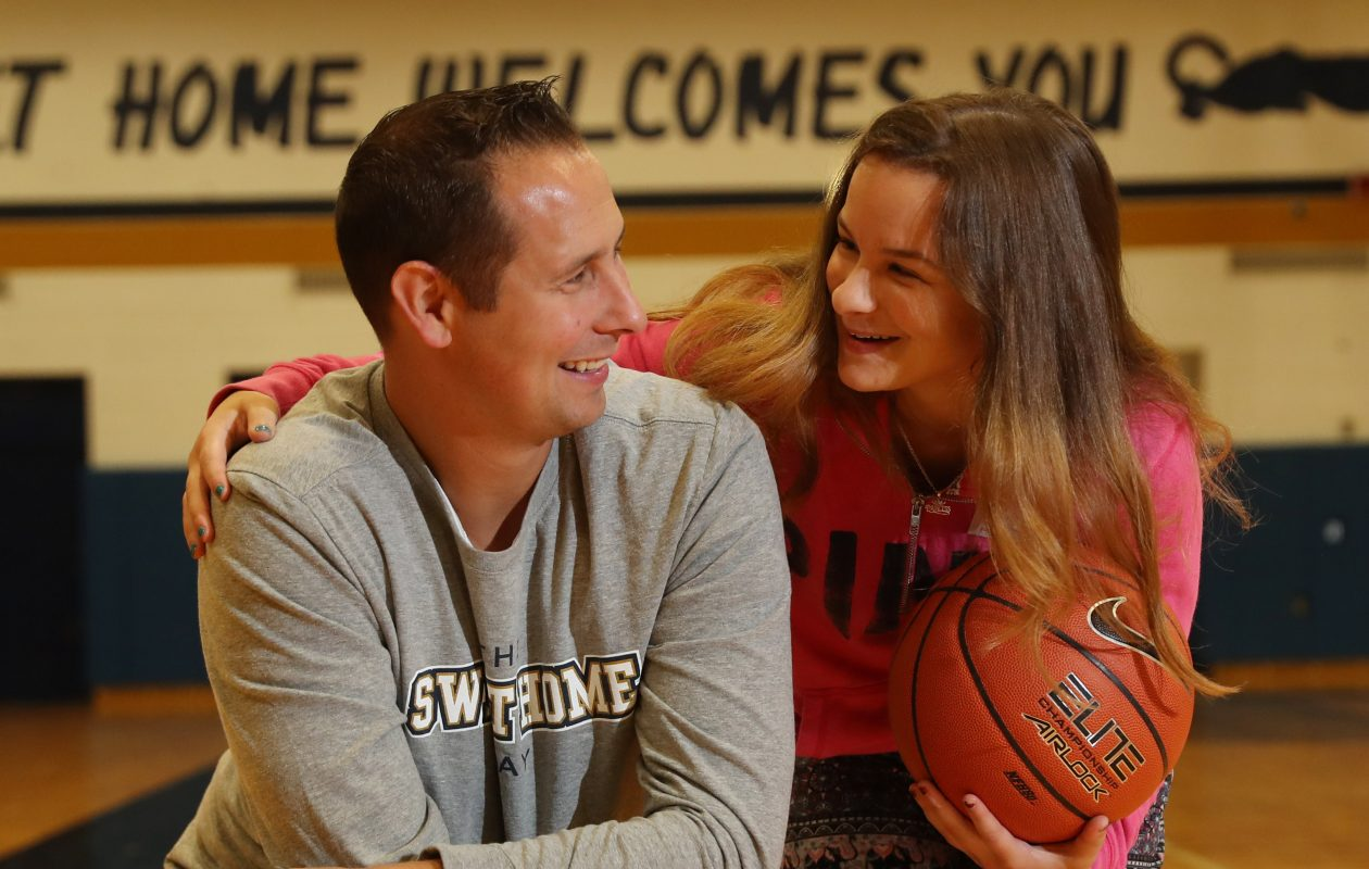 Sweet Home student Arianna Ruhland, 18, asked math teacher Steve Becker to make a basketball shot from half court during a pep rally in hopes of winning her a new TV. (Sharon Cantillon/Buffalo News)