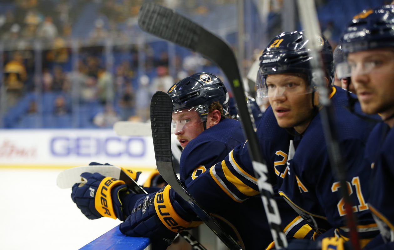 From left, Jack Eichel, Kyle Okposo and Sam Reinhart watch from the bench during a game against the Tampa Bay Lightning. (Harry Scull Jr./Buffalo News)