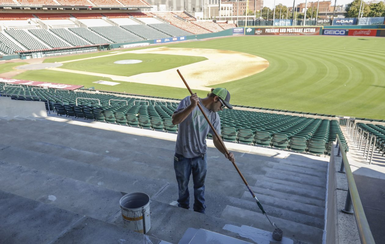 Painter Randy Jednat of Patterson and Stevens in North Tonawanda paints a stairway at the newly named Sahlen Field, where seats are being replaced. (Derek Gee/Buffalo News)