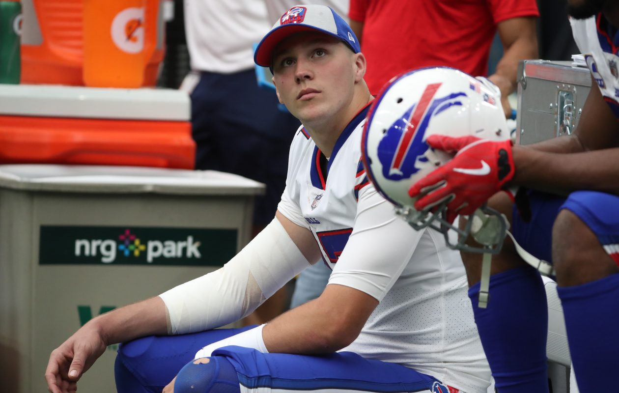 Bills quarterback Josh Allen sits on the bench with his right arm wrapped in the fourth quarter on Oct. 14. (James P. McCoy/News file photo)