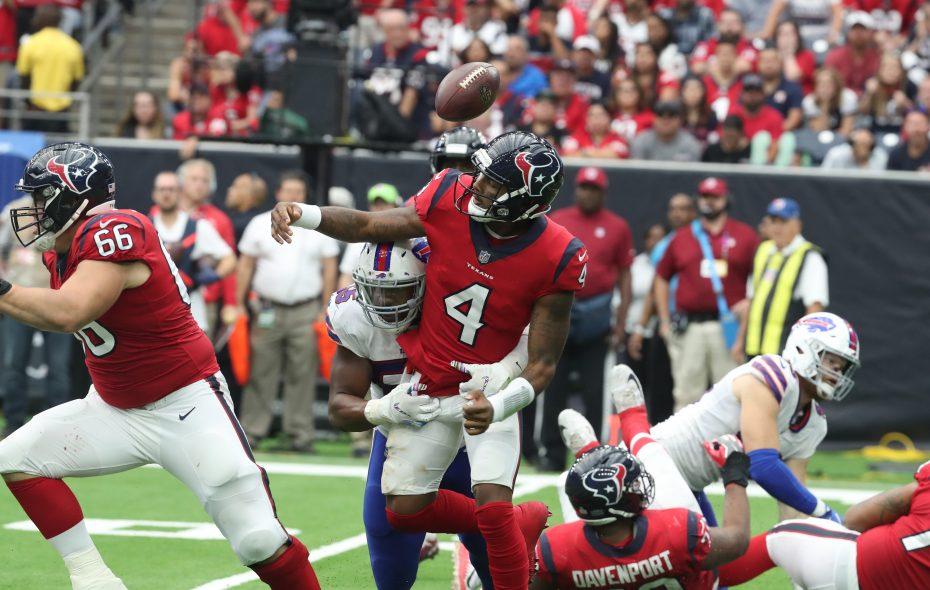 Buffalo Bills defensive end Jerry Hughes, 55, tackles Houston Texans quarterback Deshaun Watson, forcing a fumble Oct. 14 in Houston. The Texans recovered.  James P. McCoy/Buffalo News