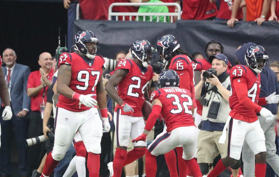 The Texans celebrate Johnathan Joseph's pick-six in the final moments. (James P. McCoy/Buffalo News)