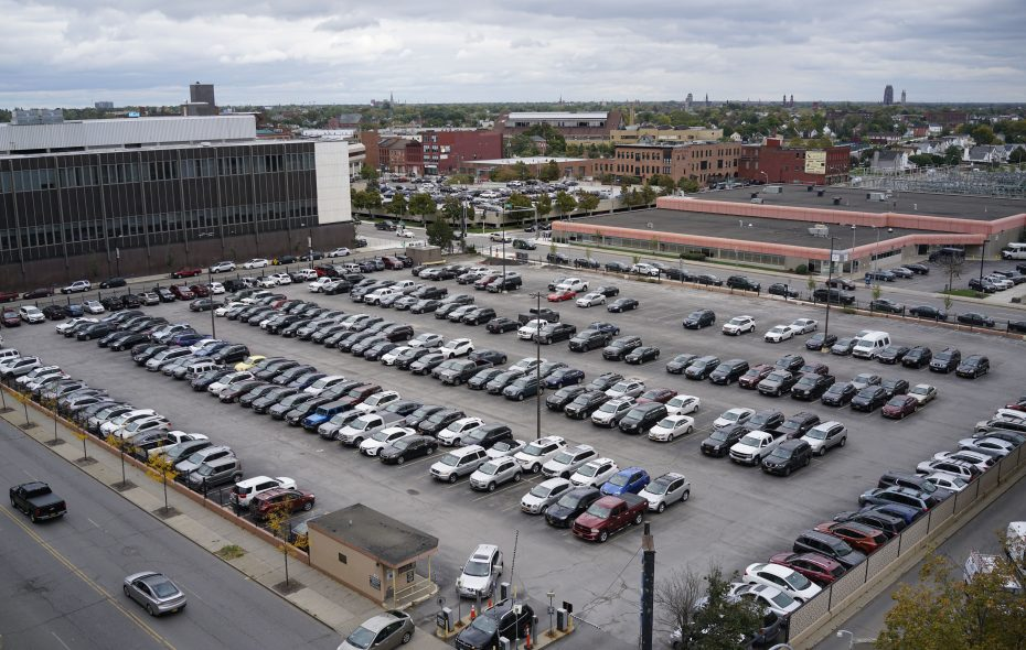 Affordable apartments and a food market are part of the development plan for this parking lot south of Clinton Street between Ellicott and Oak streets. (Derek Gee/Buffalo News)