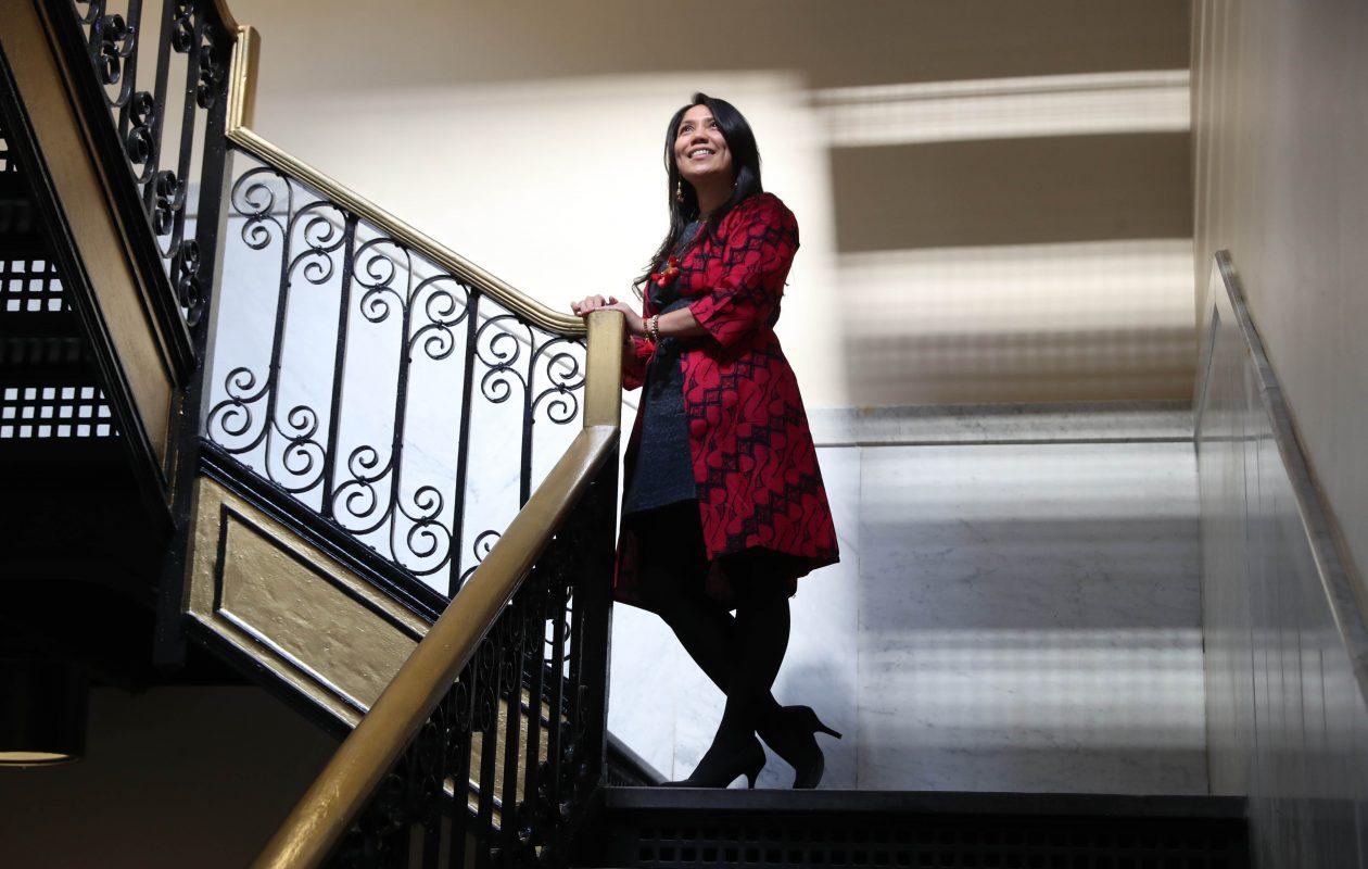 Novi Paluch, founder and owner of Sasmita Batik Indonesia, poses on a staircase at the Market Arcade. (Sharon Cantillon/Buffalo News)