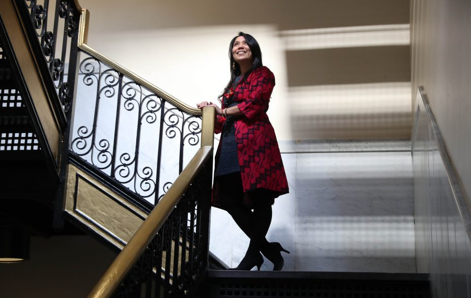 Novi Paluch, founder and owner of Sasmita Batik Indonesia, poses on a staircase at the Market Arcade. (Sharon Cantillon/Buffalo News)