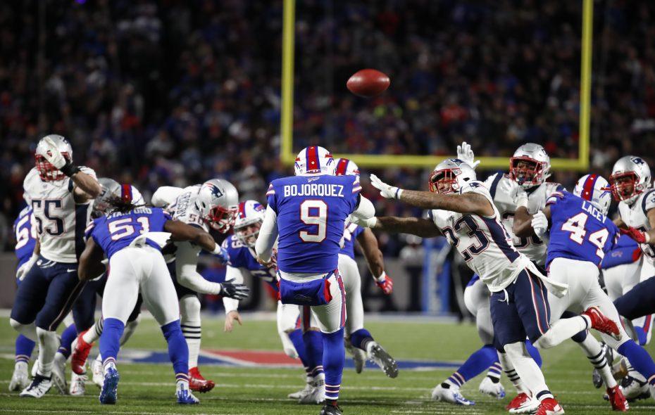Buffalo Bills punter Corey Bojorquez has his punt almost blocked by New England Patriots' Patrick Chung at New Era Field on Monday, Oct. 29, 2018. (Harry Scull Jr./Buffalo News)