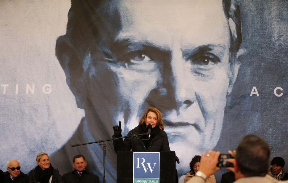 With a photo of her late husband behind her, Mary Wilson speaks during an announcement of the Ralph C. Wilson Jr. Foundation's $100 million investment into LaSalle Park and area trails. (Mark Mulville/Buffalo News)