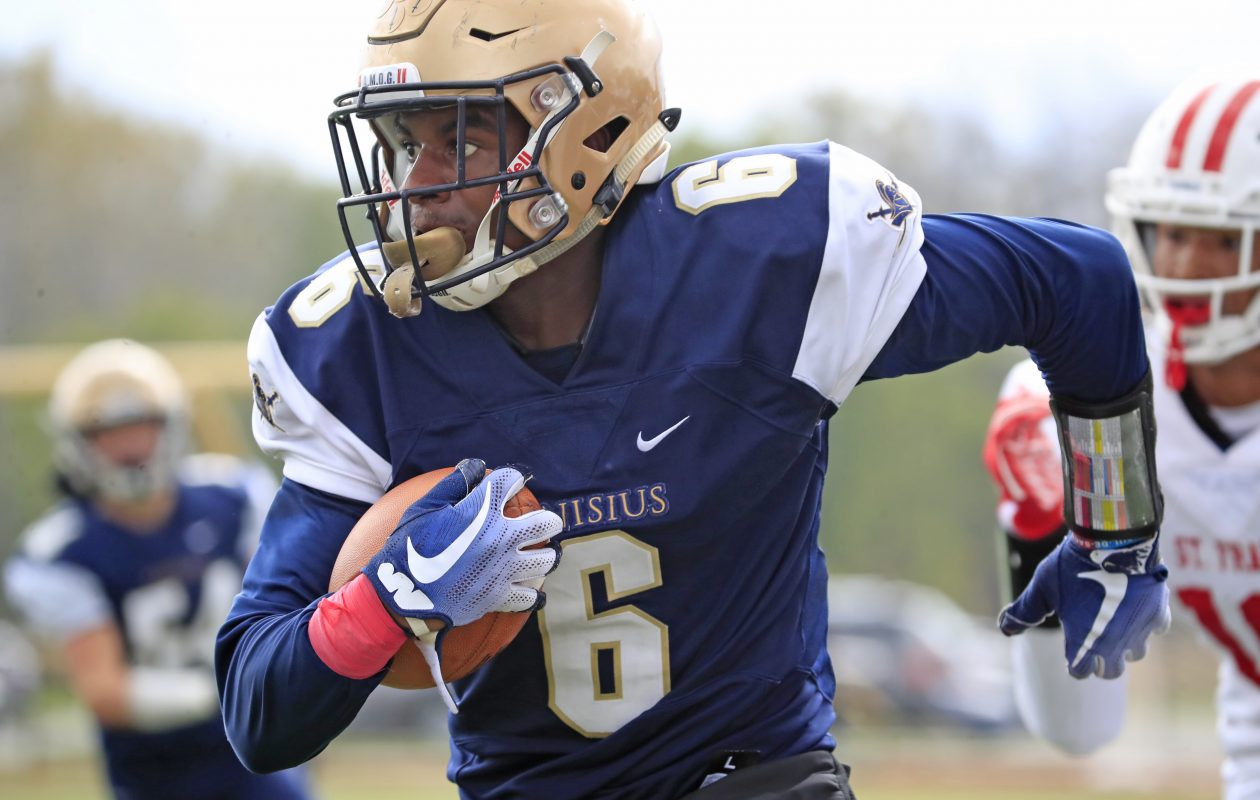 Canisius' JT Boyland returns a interception against St. Francis during the Crusaders' 25-22 win. (Harry Scull Jr./ Buffalo News)