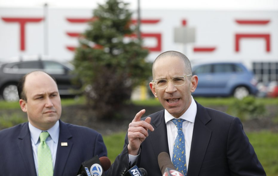 State comptroller candidate Jonathan Trichter speaks to the media on South Park Avenue outside the Tesla plant at RiverBend on Monday, Oct. 22, 2018. At left is Erie County GOP Chair Nick Langworthy. (Derek Gee/Buffalo News)