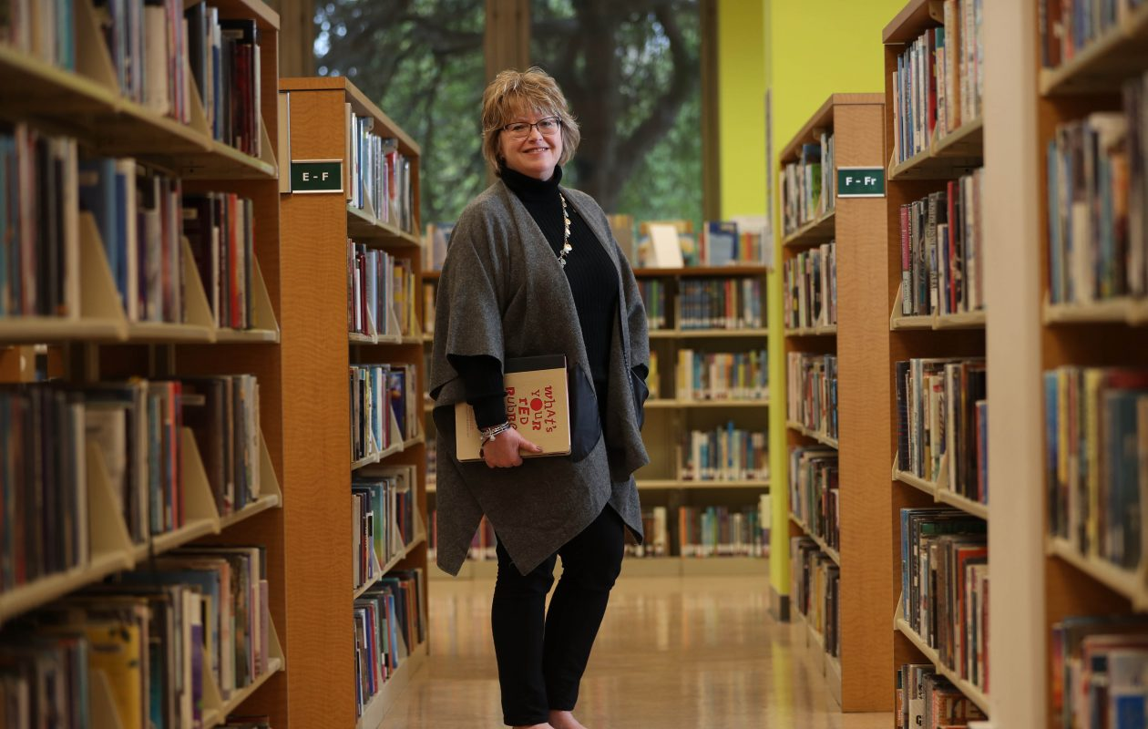 Mary Jean Jakubowski is   director of the Buffalo & Erie County Public Library system. She was photographed this week at the Central Library  with her favorite book, 'What's Your Red Rubber   Ball?'  by author/speaker Kevin Carroll. (Sharon Cantillon/Buffalo News)