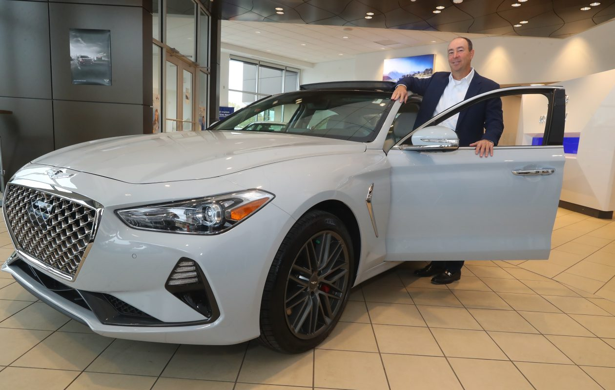 Craig Schreiber, a Northtown Automotive co-owner, with a new Genesis vehicle. (John Hickey/Buffalo News)