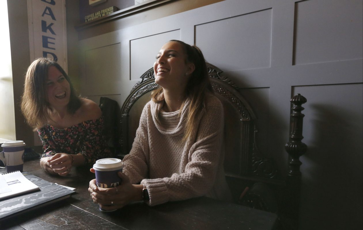 Emma Ballowe, right, longtime girlfriend of Conor Long, remembers some of what she called his 'goofball' moments as his sister Meghan, left, listens. (Robert Kirkham/Buffalo News)