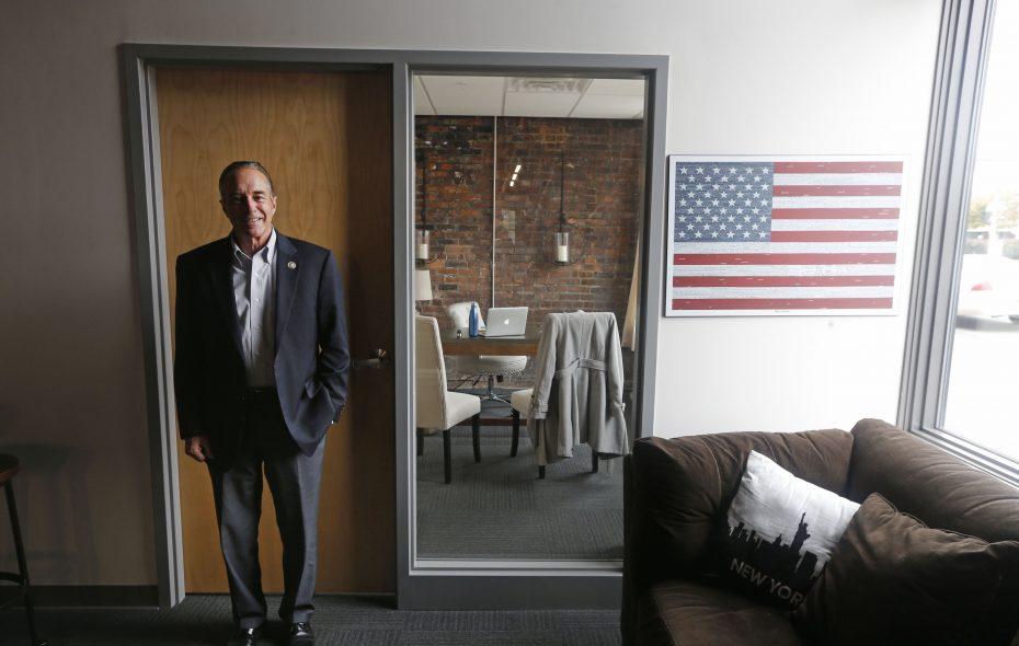 U.S. Congressman Chris Collins poses next to an American flag at a downtown office on Thursday, Oct. 25, 2018.  (Robert Kirkham/Buffalo News)