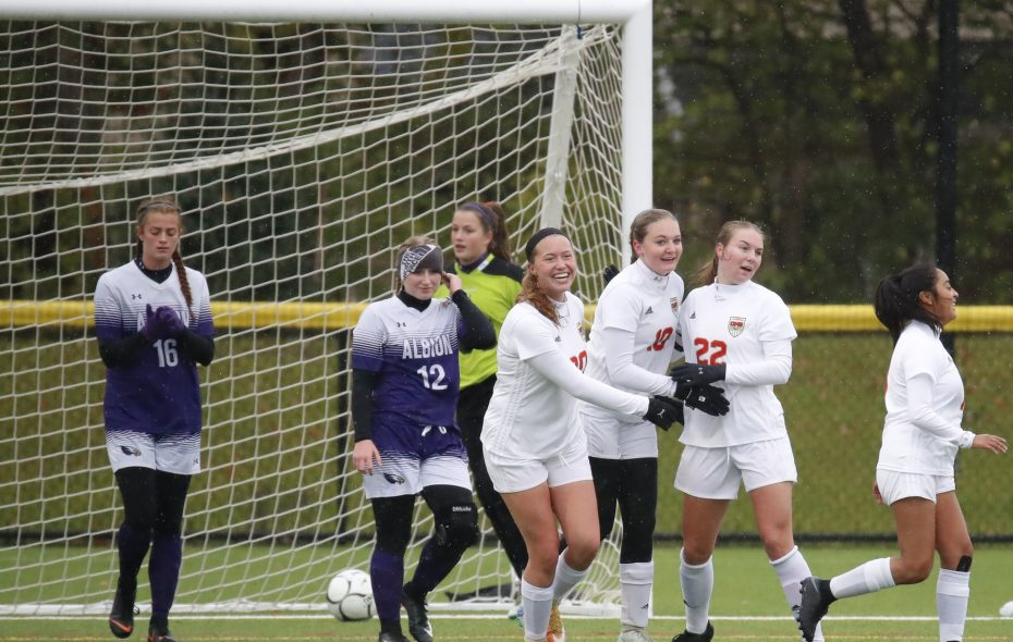 Olean player Justine Brooks (10) is congratulated on her goal against Albion during the Section VI B-1 soccer championships at Williamsville East. (Harry Scull Jr./Buffalo News)