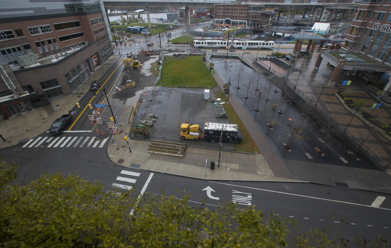 The paved lot at the corner of Washington and Scott streets is the site on which Benderson Development has been planning a new building. (John Hickey/Buffalo News)
