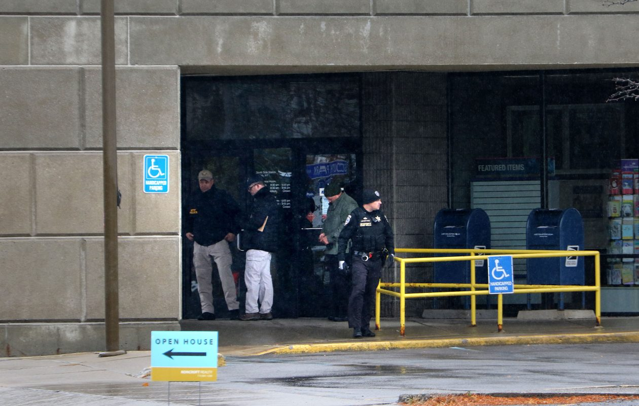 Buffalo Police investigate a suspicious device at the post office on South Park in South Buffalo Saturday, October 27, 2018.    (Mark Mulville/Buffalo News)