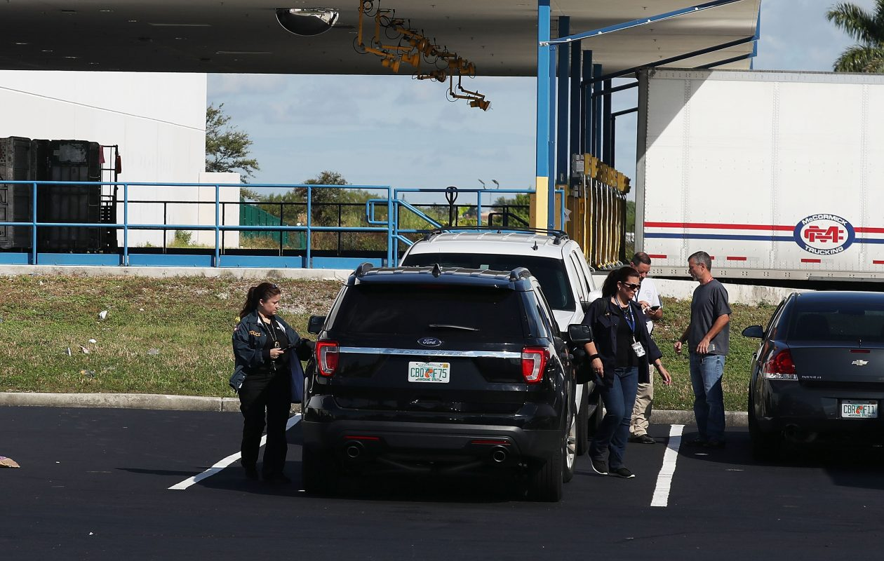 U.S. Postal workers at the U.S. Postal Service mail facility in Opa Lacka, Fla., where federal law enforcement personnel are investigating a pipe bomb that passed through the facility addressed to Sen. Cory Booker. (Photo by Joe Raedle/Getty Images)