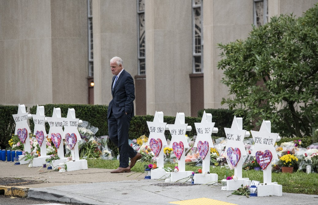 Mourners visit a makeshift memorial outside the Tree of Life congregation, where 11 people died in a shooting rampage on Saturday. (New York Times)