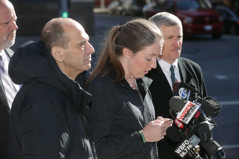 Siobhan O'Connor said a prayer before meeting with the news media Tuesday along with her lawyer, Mitchell Garabedian, left, and, Robert Hoatson. (John Hickey/Buffalo News)