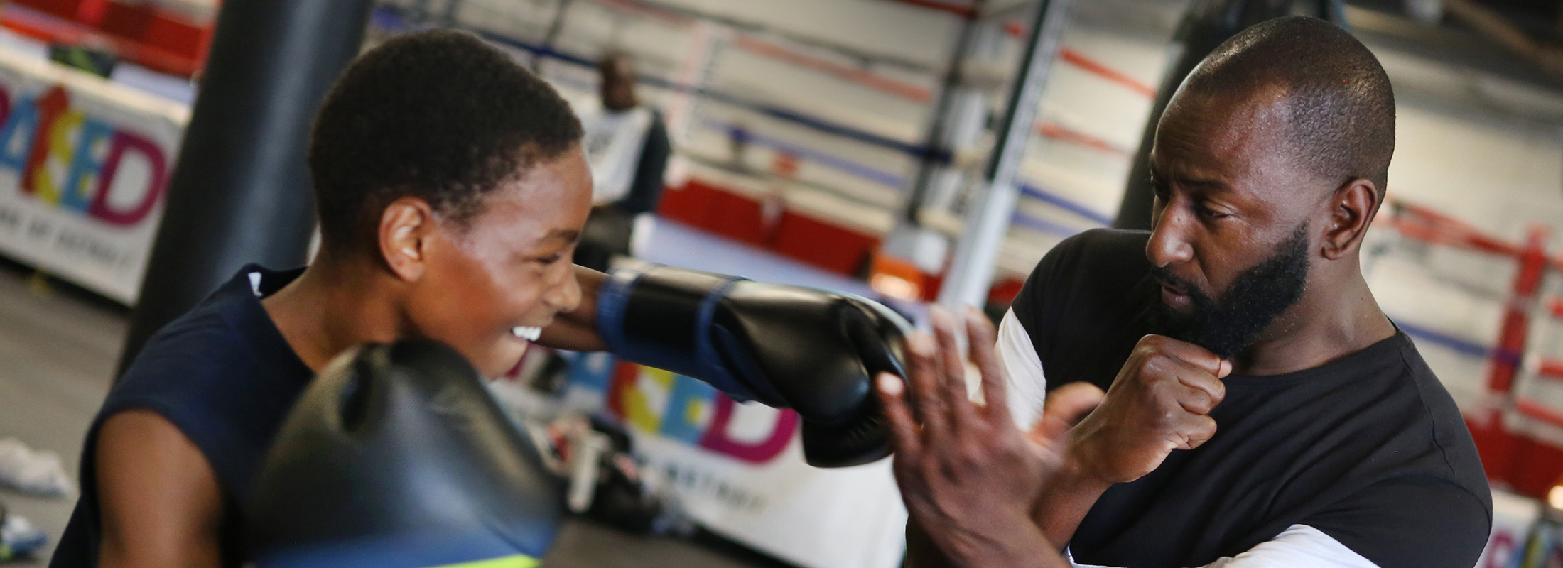 Detroit's Downtown Boxing Gym founder Khali Sweeney, right, coaches a young boxer at the after school program that the Ralph C. Wilson, Jr. Foundation helps support with grant money.  (Photo by J. Kyle Keener)