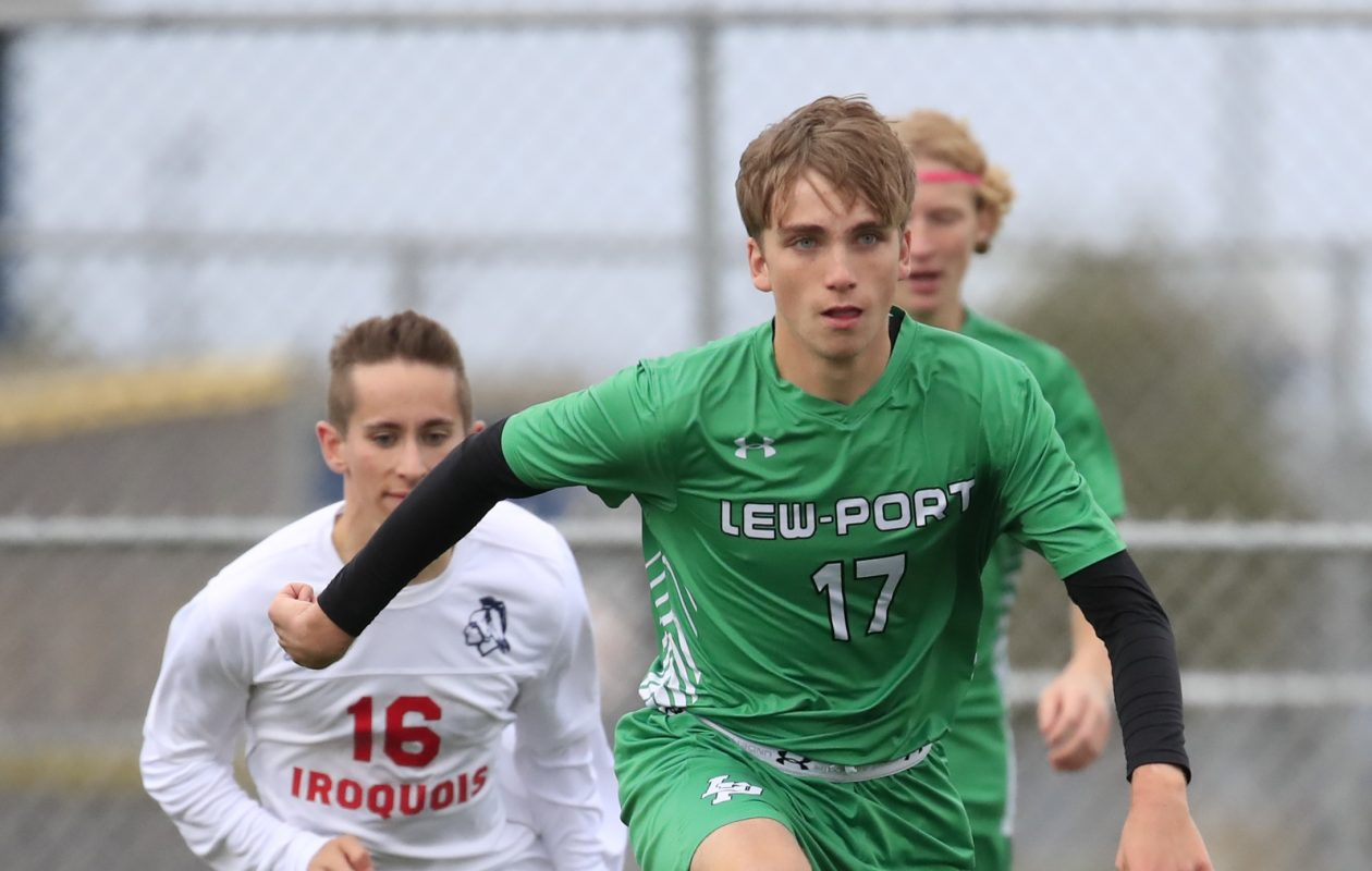 Lewiston-Porter senior Andrew Perreault has taken advantage of a recent NFL rule to become the Lancers' top cross country runner while also playing for the soccer team. (Harry Scull Jr/.Buffalo News)