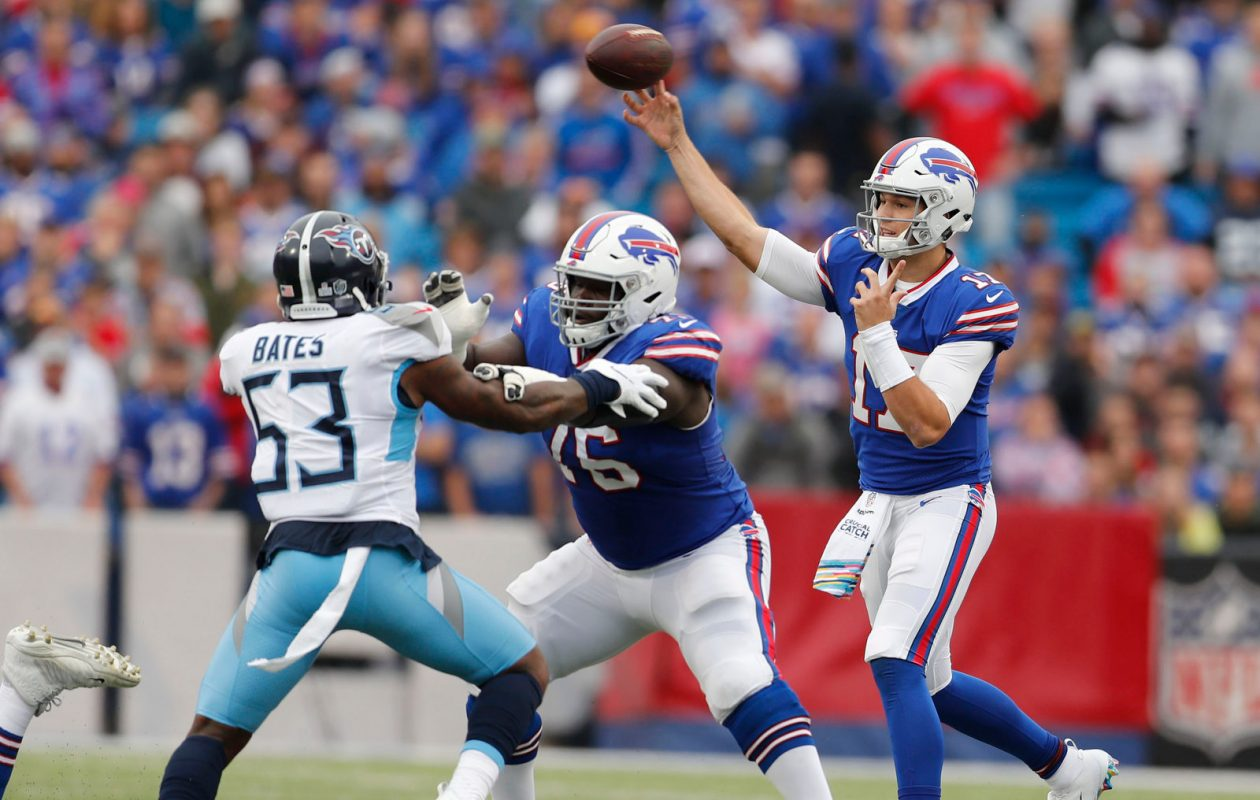 Josh Allen hits a pass in the first quarter. (Mark Mulville/Buffalo News)