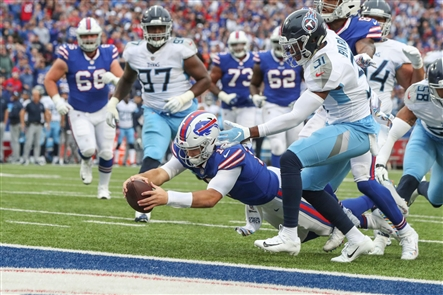 Bills quarterback Josh Allen dives for a touchdown Sunday in the first quarter against the Titans. (Harry Scull Jr./Buffalo News)