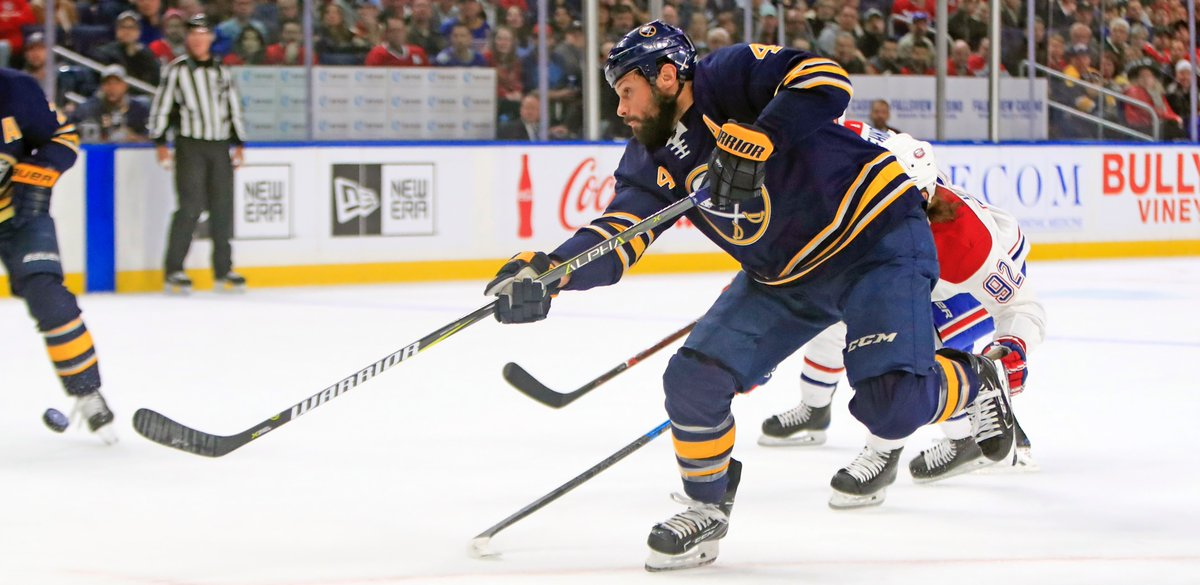Zach Bogosian takes a shot in the first period (Harry Scull Jr./Buffalo News).