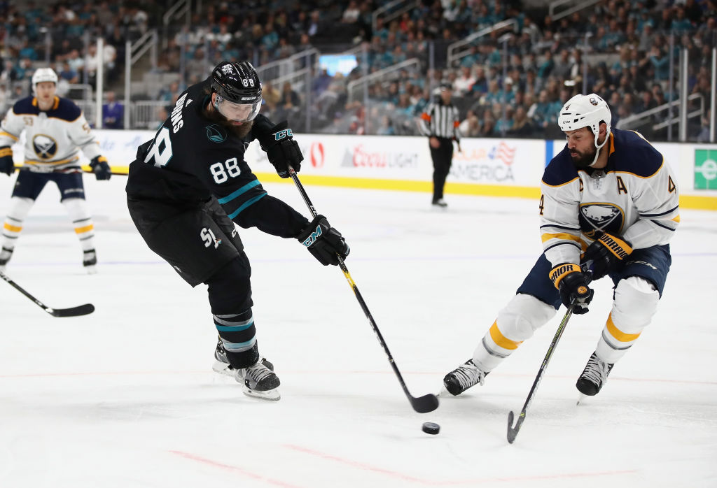 Sabres defenseman Zach Bogosian defends against San Jose's Brent Burns (Getty Images).