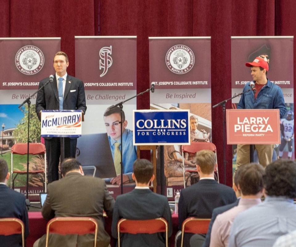 Democrat Nathan McMurray and Reform Party candidate Larry Piegza showed up for Tuesday's debate at St. Joseph's Collegiate Institute, but Rep. Chris Collins, a Clarence Republican, did not. (Audience photo.)