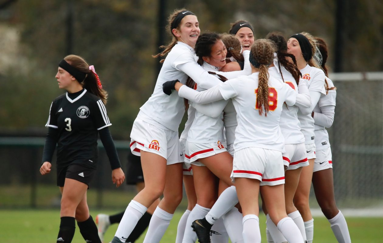 The Williamsville East girls soccer team celebrates in its 1-0 win against Niagara Wheatfield in a Section VI A1 final Saturday at Williamsville North. (Harry Scull Jr./The Buffalo News)