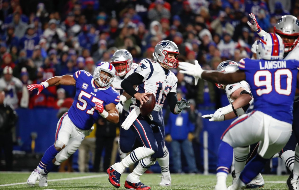 The Buffalo Bills' Lorenzo Alexander chases down Patriots quarterback Tom Brady. (Harry Scull Jr./News file photo)
