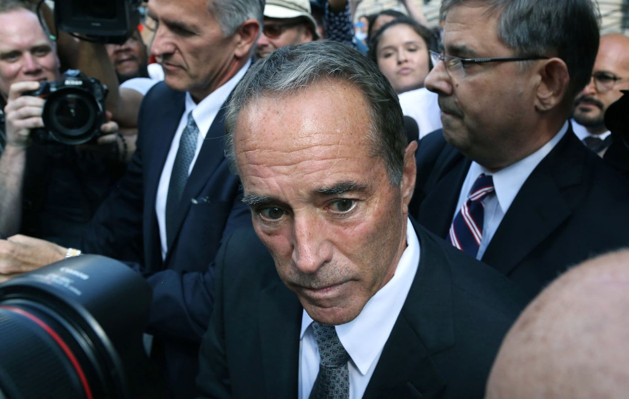 Rep. Chris Collins is mobbed by the press as he leaves U.S. District Court in Manhattan after his arraignment last August. (Jefferson Siegel/Special to The News)
