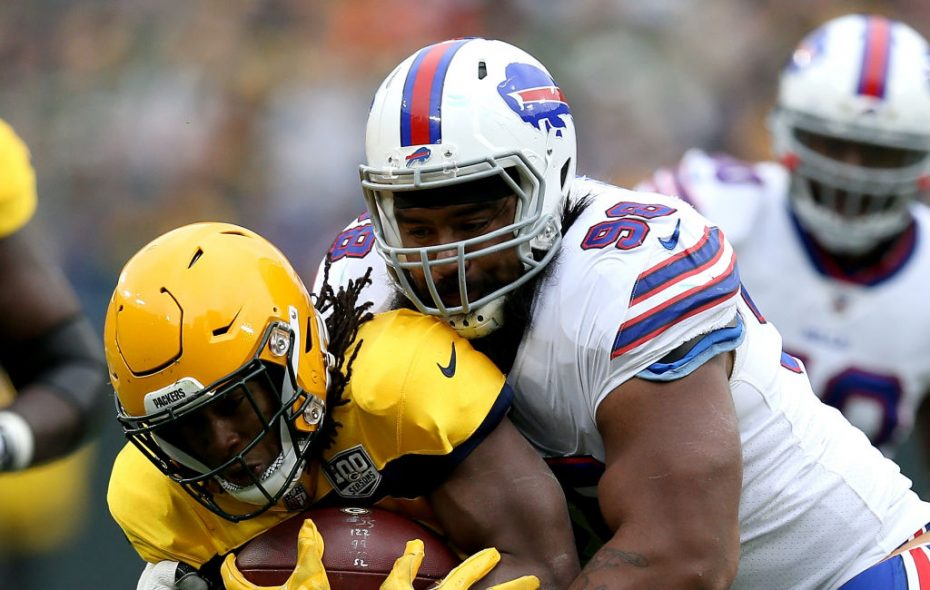 Green Bay's Aaron Jones is tackled by Bills defensive tackle Star Lotulelei. (Getty Images)