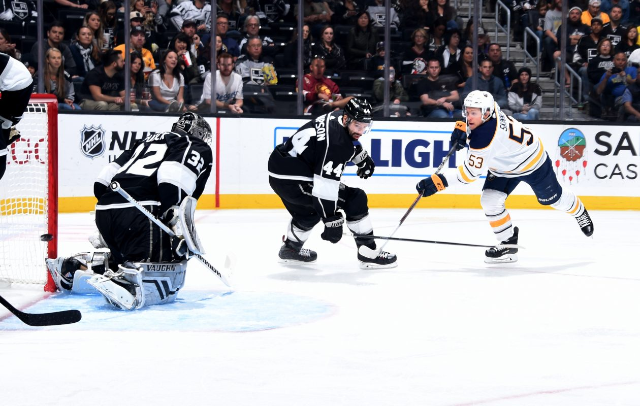 Jeff Skinner burns Kings forward Nate Thompson and goalie Jonathan Quick early in the second period for his first goal of the game (Getty Images).