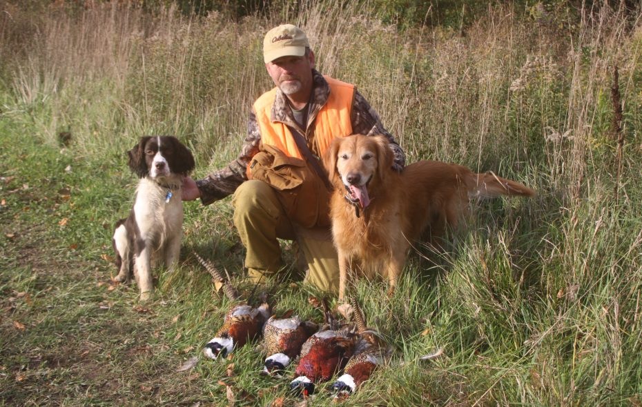 Joel Spring, center, is flanked by Fred, left, and Max as they pose after a successful morning hunt at Wilson-Tuscarora State Park.