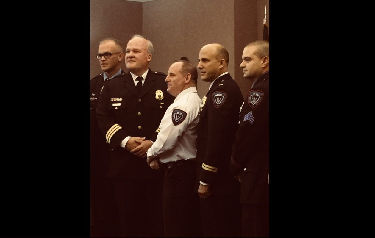 Cheektowaga Police Chief David J. Zack, center, announced promotions during Tuesday's Town Board meeting. From left: Lt. Christopher Geelan, Assistant Chief Michael J. Sliwinski, Zack, Capt. Brian Gould and Sgt. Garrett R. Slawatycki. (Jane Kwiatkowski Radlich/Buffalo News)