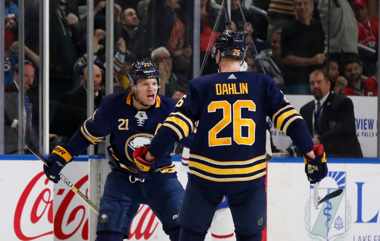 Kyle Okposo celebrates his game-winning goal Thursday night for the Sabres against Montreal with Rasmus Dahlin. (Harry Scull Jr./Buffalo News)