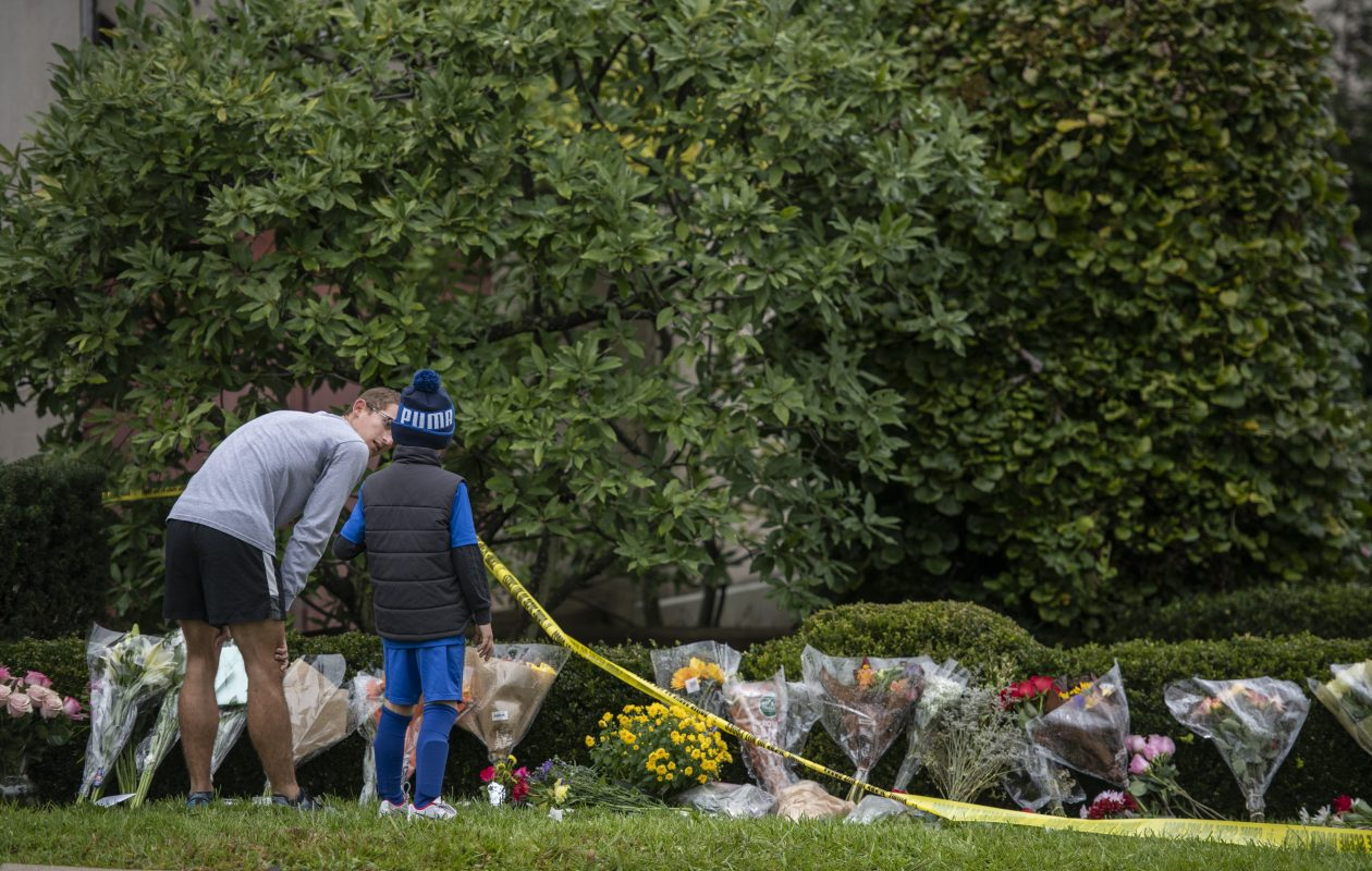 Flowers are left on the grounds of the Tree of Life Congregation in Pittsburgh, where 11 people were killed in a mass shooting Saturday, Oct. 28, 2018. (Michael Henninger/The New York Times)