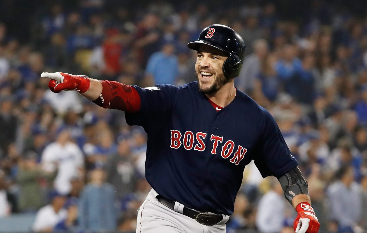Steve Pearce celebrates his eighth-inning home run Sunday as the Red Sox wrapped up the World Series. (Getty Images)