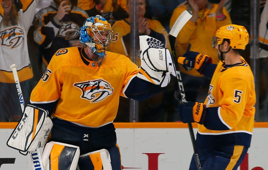 Nashville defenseman Dan Hamhuis (5) gives it up to goalie Pekka Rinne after the Predators' win over Minnesota on Tuesday (Getty Images).