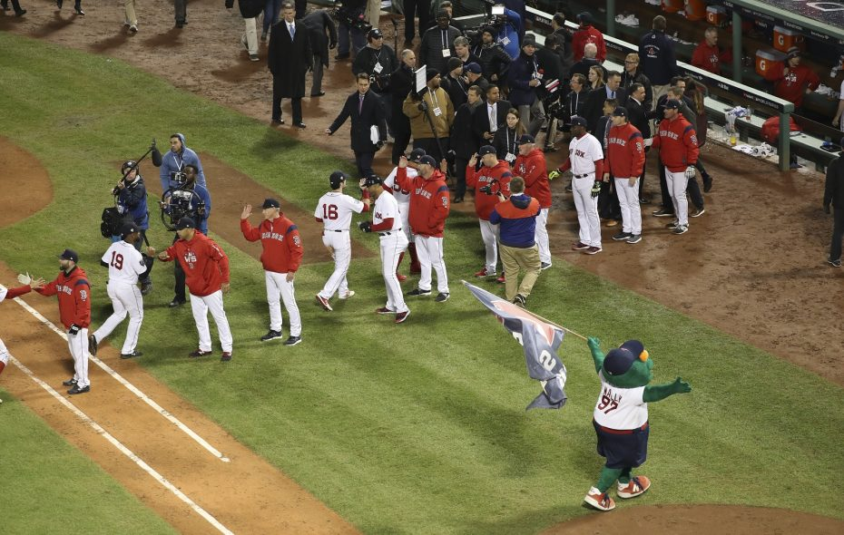 Boston Red Sox players celebrate at the end of Game 1 of the World Series against the Los Angeles Dodgers, at Fenway Park in Boston. (Chang W. Lee/New York Times)